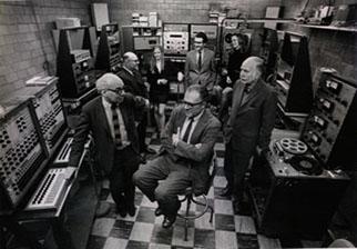 Ussachevsky, Babbitt, Arel, Smiley, Davidovsky, Shields, and Luening in Studio 317 at the C-PEMC