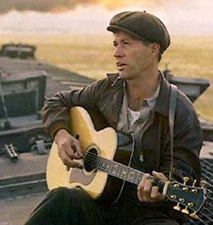 David Carradine as Woody Guthrie